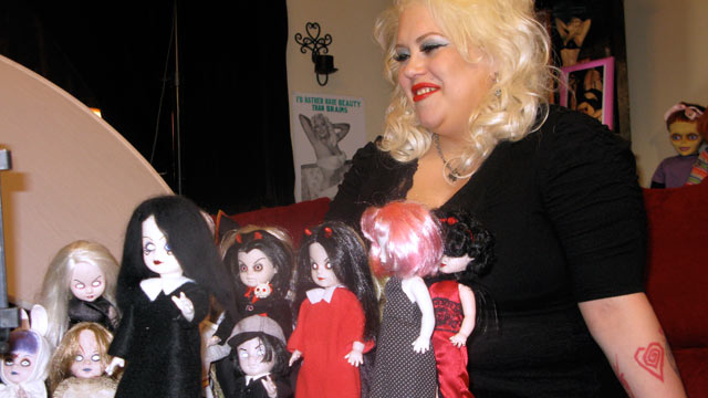 PHOTO: Marilyn Mansfield, a doll collector, sits in front of her dolls.