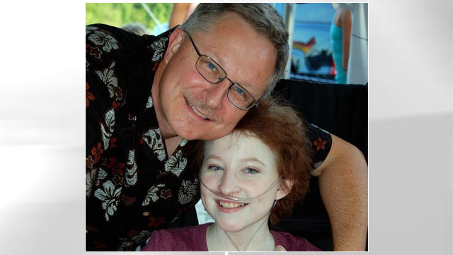PHOTO: Esther Earl and her dad sit together the month before she died.