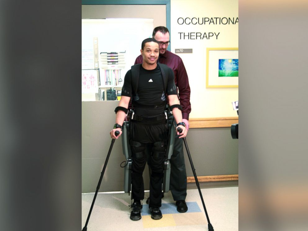 PHOTO: Allan Kozlowski helps his patient Errol Samuels walk using the ReWalk exoskeleton at Mount Sinai Hospital.