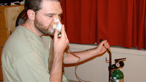 PHOTO Justin Ott, 31, uses oxygen therapy to stop the debilitating pain of his cluster headaches.