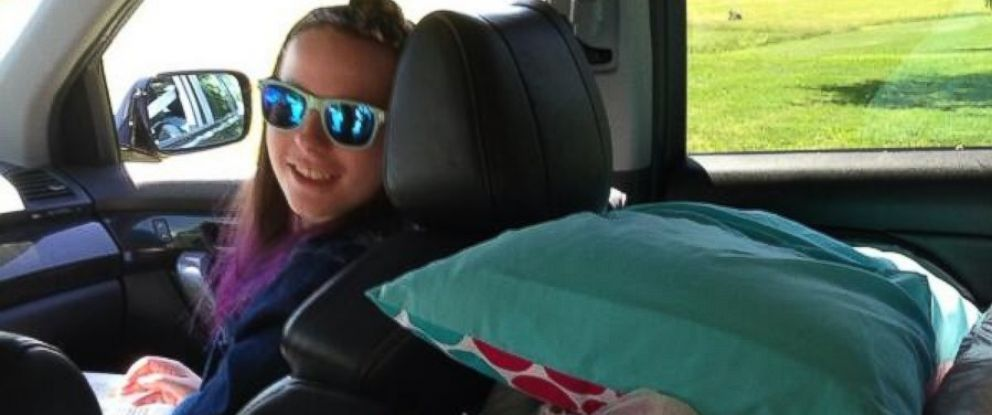 "Rev. Patrick Mahoney posted this photo on Twitter on June 18, 2014 with the caption, ""So excited! Here is Justina in her moms car with her stuff ready to go home!"""