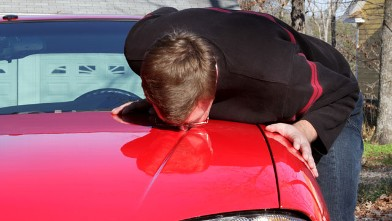 PHOTO: Nathaniel, who is addicted to his car, kissing it in his driveway.