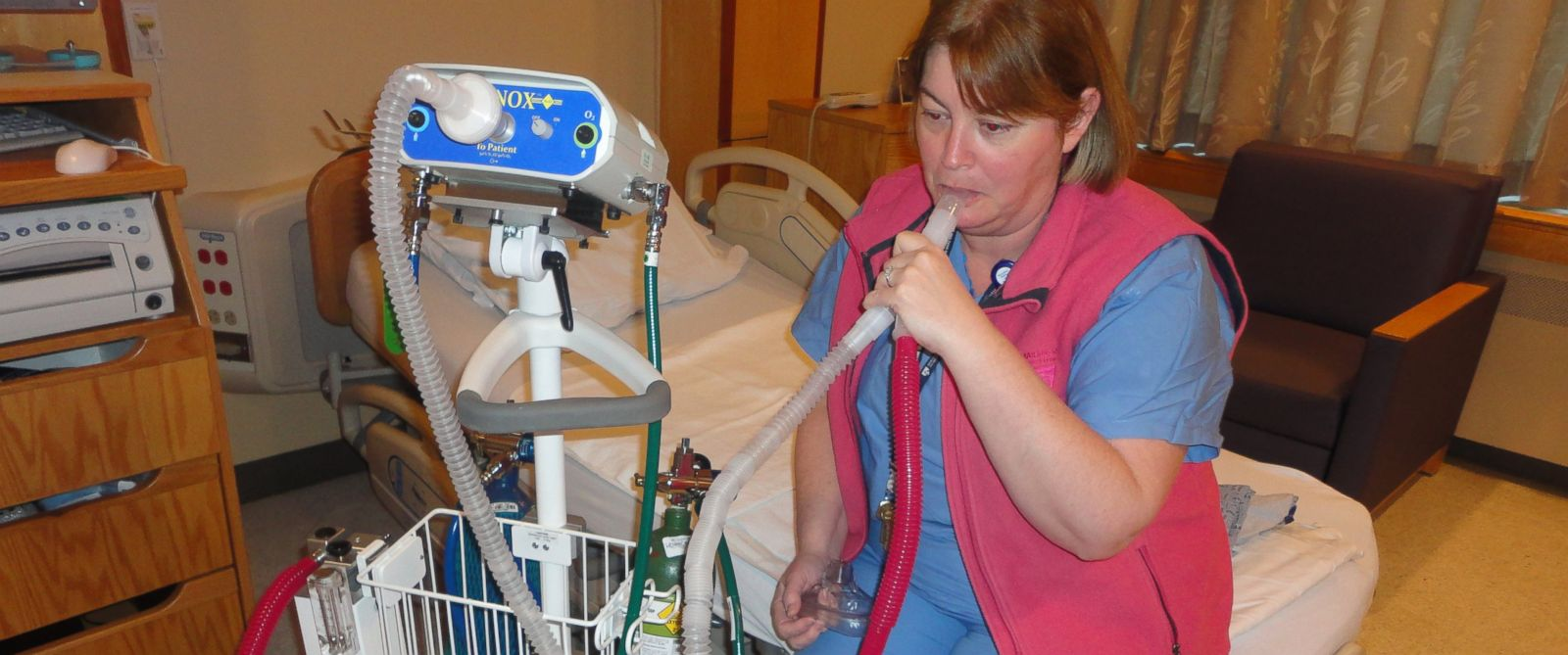 PHOTO: Kate McGovern, a nurse educator and midwife at Brigham and Women's Hospital in Boston, Mass., demonstrates the equipment that delivers nitrous oxide to women who elect to use it for pain relief during labor.