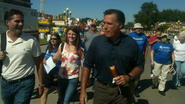 PHOTO: Mitt Romney eats a corn dog while at the Iowa State Fair.