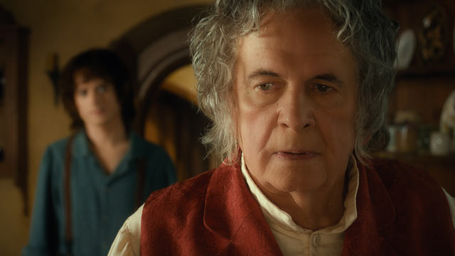 "PHOTO: Elijah Wood as Frodo and Ian Holm as Bilbo Baggins in the fantasy adventure ""The Hobbit: An Inexpected Journey."""