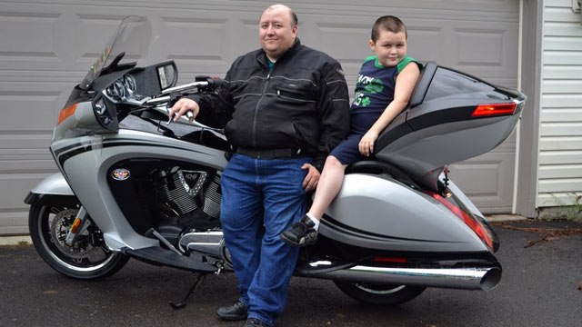 """PHOTO:Stay-at-home dad Wayne Moyer, shown with son Matt, says his bike is his """"manly escape."""""""