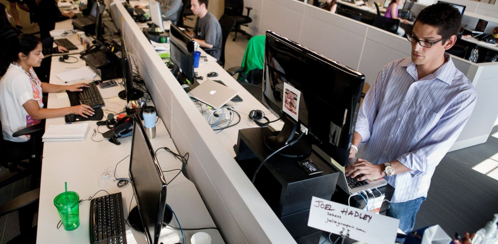 PHOTO: Joel Hadley, right, uses a standing desk at the Groupon offices in Chicago, July 30, 2012.