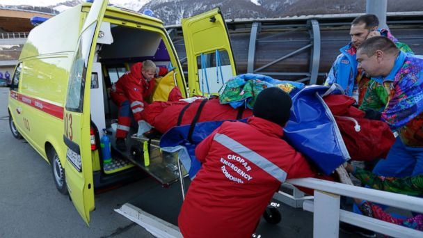 PHOTO: A track worker is loaded into an ambulance after he was injured when a forerunner bobsled hit him just before the start of the mens two-man bobsled training at the 2014 Winter Olympics on Feb. 13, 2014, in Krasnaya Polyana, Russia.