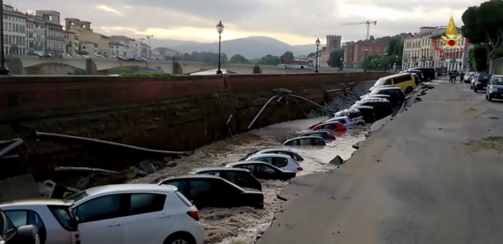 VIDEO: A section of road collapsed and filled with water beside the Arno River in Florence.