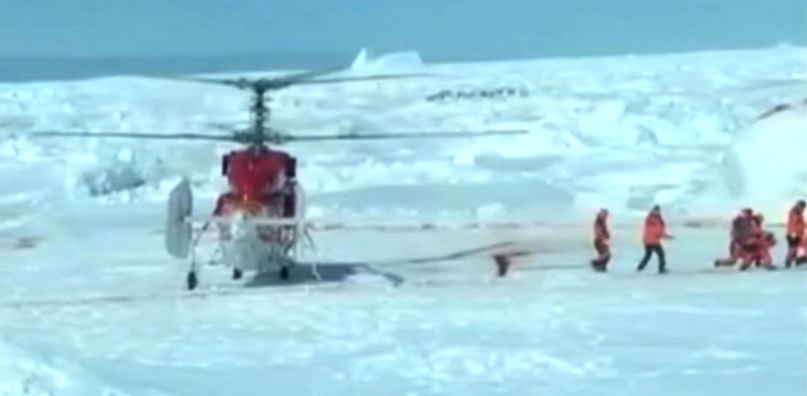 PHOTO: A helicopter lands on ice to rescue the passengers of the Russian ship MV Akademik Shokalskiy that has been trapped in ice for over a week, Jan. 2, 2014.