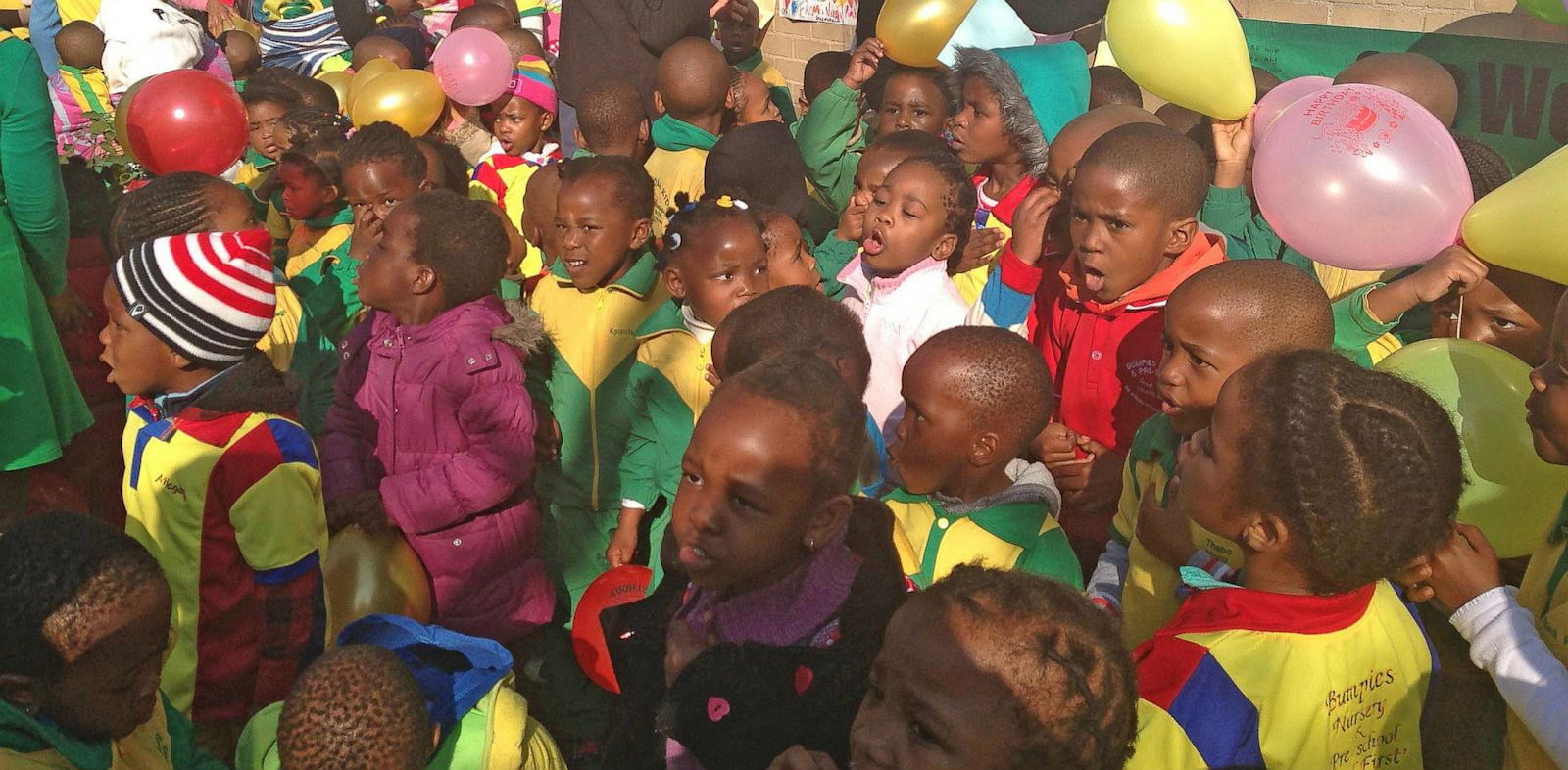 "PHOTO: Children sing ""Happy Birthday"" to Nelson Mandela"