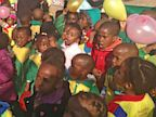 PHOTO: Children sing Happy Birthday to Nelson Mandela