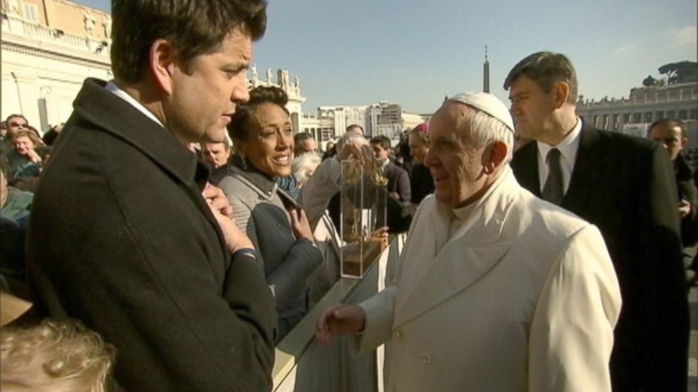 PHOTO: Pope Francis shakes hands with Good Morning Americas Josh Elliott and Robin Roberts, Dec. 18, 2013, in Vatican City.