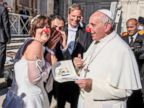 PHOTO: Vatican Pope Francesco jokes with the newlyweds of the Rainbow Association Marco Lagulli Onlus, which deals with the clownterapia in hospitals, Nov. 6, 2013.