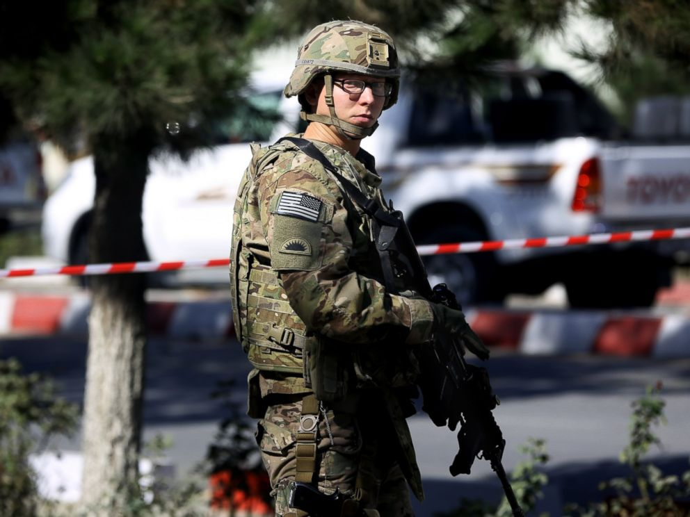 PHOTO: A U.S. military force stands guard at the site of a suicide attack near a U.S. military camp in Kabul, Afghanistan, Sept. 16, 2014.