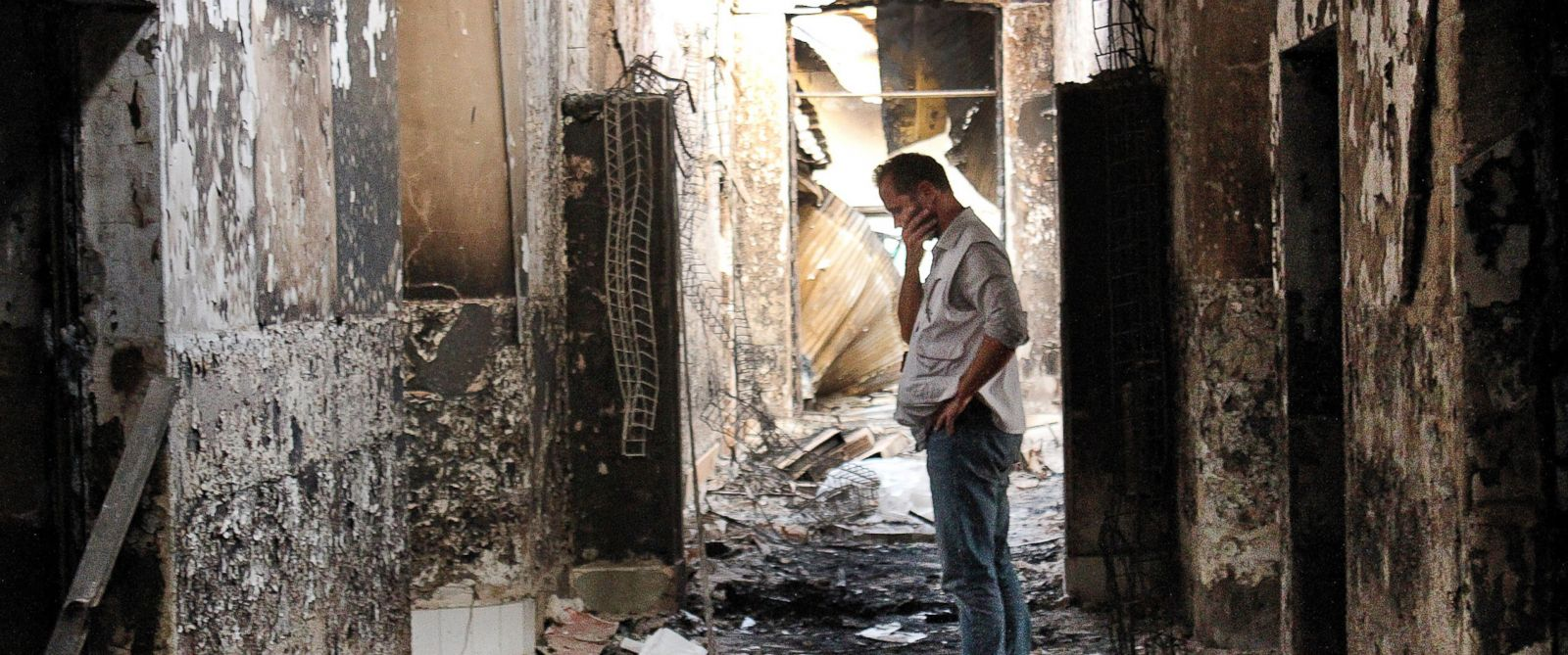 PHOTO: In this Oct. 16, 2015, file photo, an employee of Doctors Without Borders walks inside the charred remains of the organizations hospital after it was hit by a U.S. airstrike in Kunduz, Afghanistan.