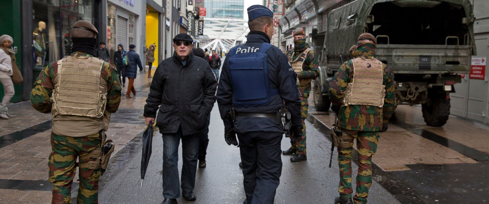 PHOTO: Belgian Army soldiers and police patrol an otherwise busy shopping street in Brussels on Saturday, Nov. 21, 2015.