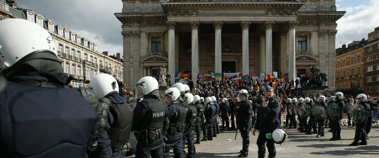 PHOTO: Police in riot gear sweep the area in front of the old bourse clear of right wing demonstrators next to one of the memorials to the victims of the recent Brussels attacks, at the Place de la Bourse in Brussels, March, 27, 2016.
