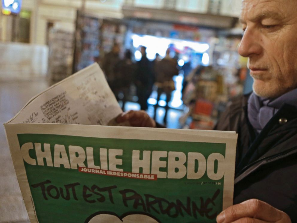 PHOTO: Jean Paul Bierlein reads the latest issue of Charlie Hebdo outside a newsstand in Nice, southeastern France, Jan. 14, 2015.