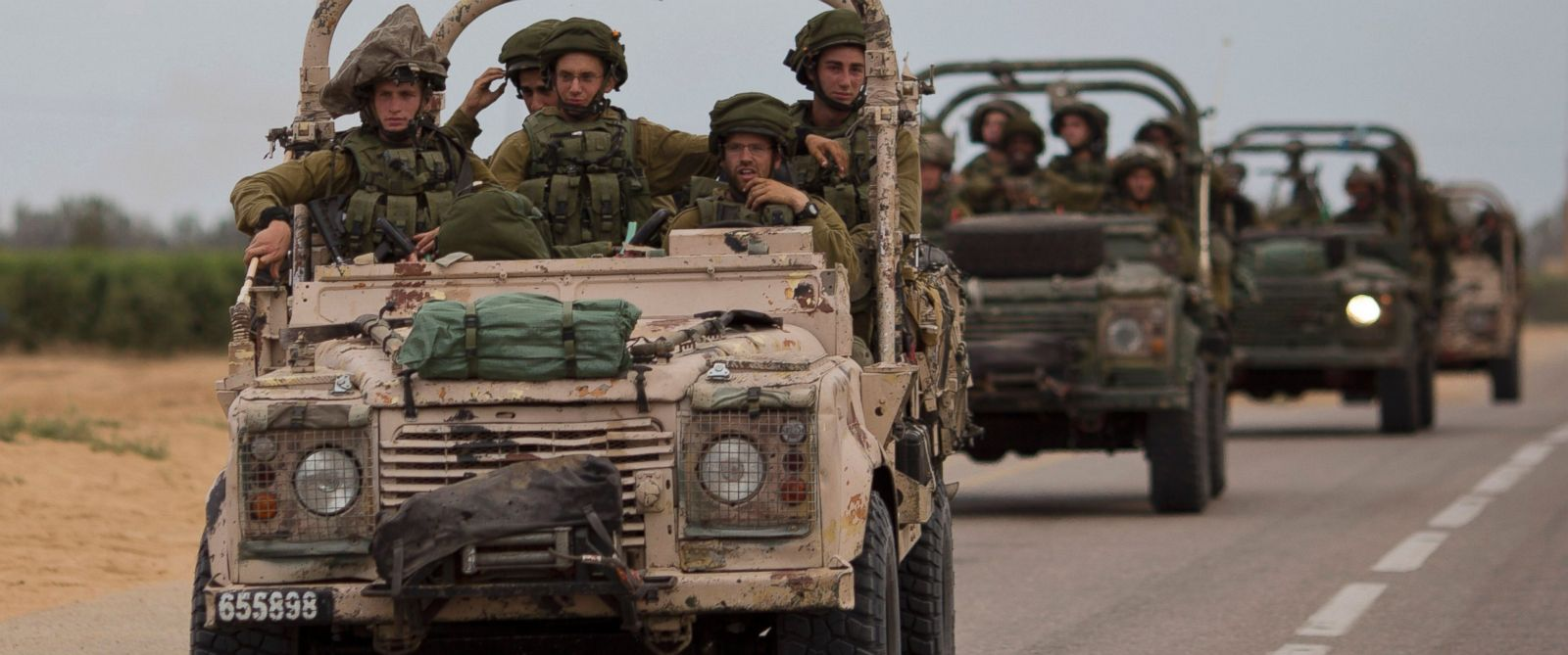 PHOTO: Israeli soldiers ride on a military vehicle near the Israel-Gaza Border, Thursday, July 17, 2014.