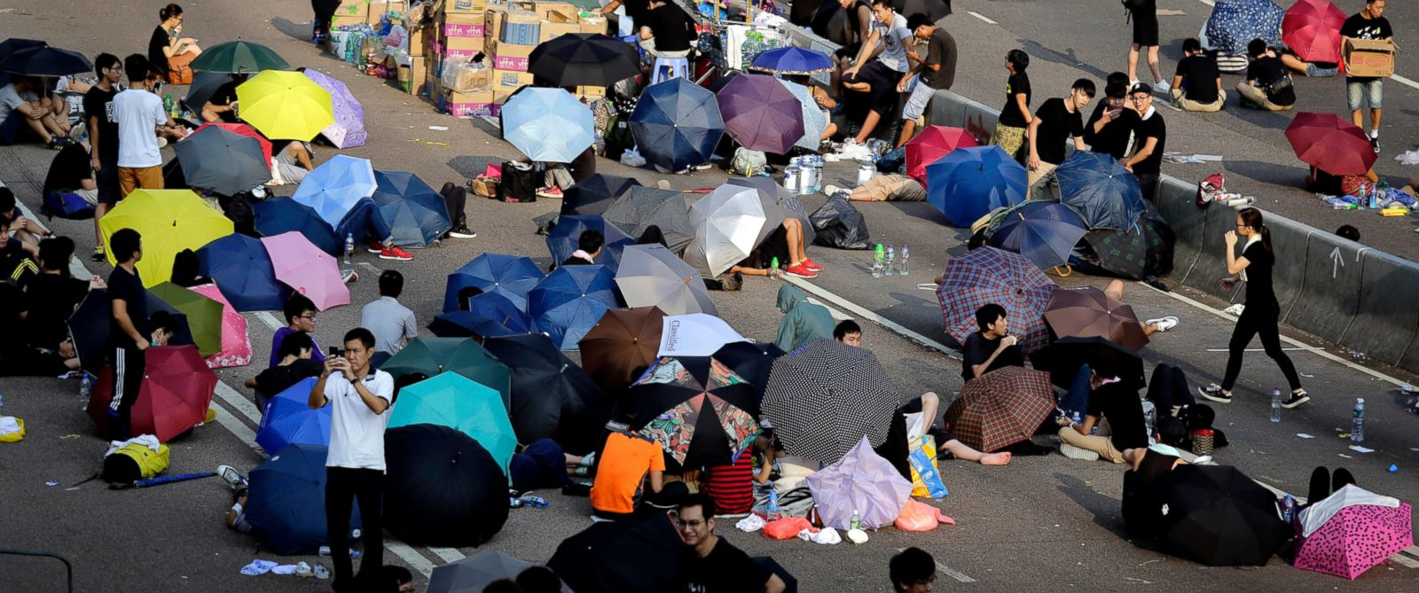 PHOTO: Student activists sleep on a road, many under the shade of umbrellas, near the government headquarters where pro-democracy activists have gathered and made camp, Sept. 30, 2014, in Hong Kong.