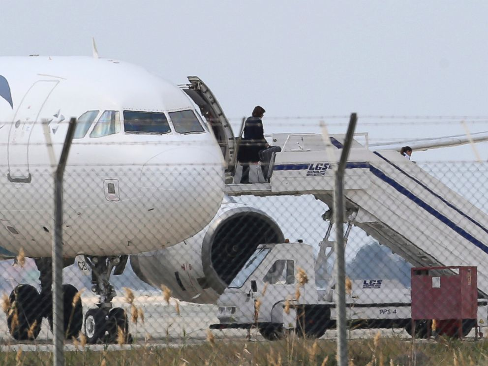 PHOTO: A passenger leaves a hijacked EgyptAir aircraft after landing at Larnaca Airport in Cyprus, March 29, 2016.