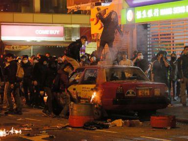 PHOTO: Rioters throw bricks at police in Mong Kok district of Hong Kong, Feb. 9, 2016.