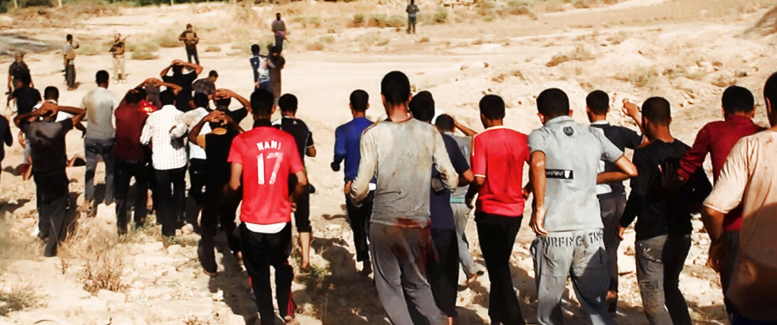 PHOTO: This image posted on a militant website on Saturday, June 14, 2014, appears to show militants from the al-Qaida-inspired Islamic State of Iraq and the Levant (ISIL) leading captured Iraqi soldiers wearing plain clothes to an open field.