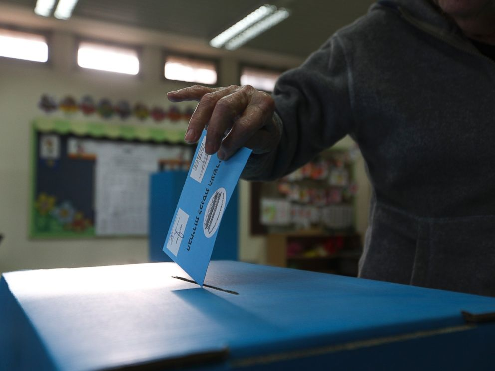 A man cast his vote during legislative elections in Tel Aviv, Israel, Tuesday, March 17, 2015. Israelis are voting in early parliament elections following a campaign focused on economic issues.