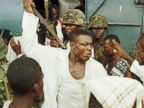 PHOTO: Joshua Milton Blahyi, a former Liberian factional fighter known as General Butt Naked, threatens a fellow combatant with a knife during an argument outside the Barclay Training Center army barracks in Monrovia, Liberia, May 15, 1996.
