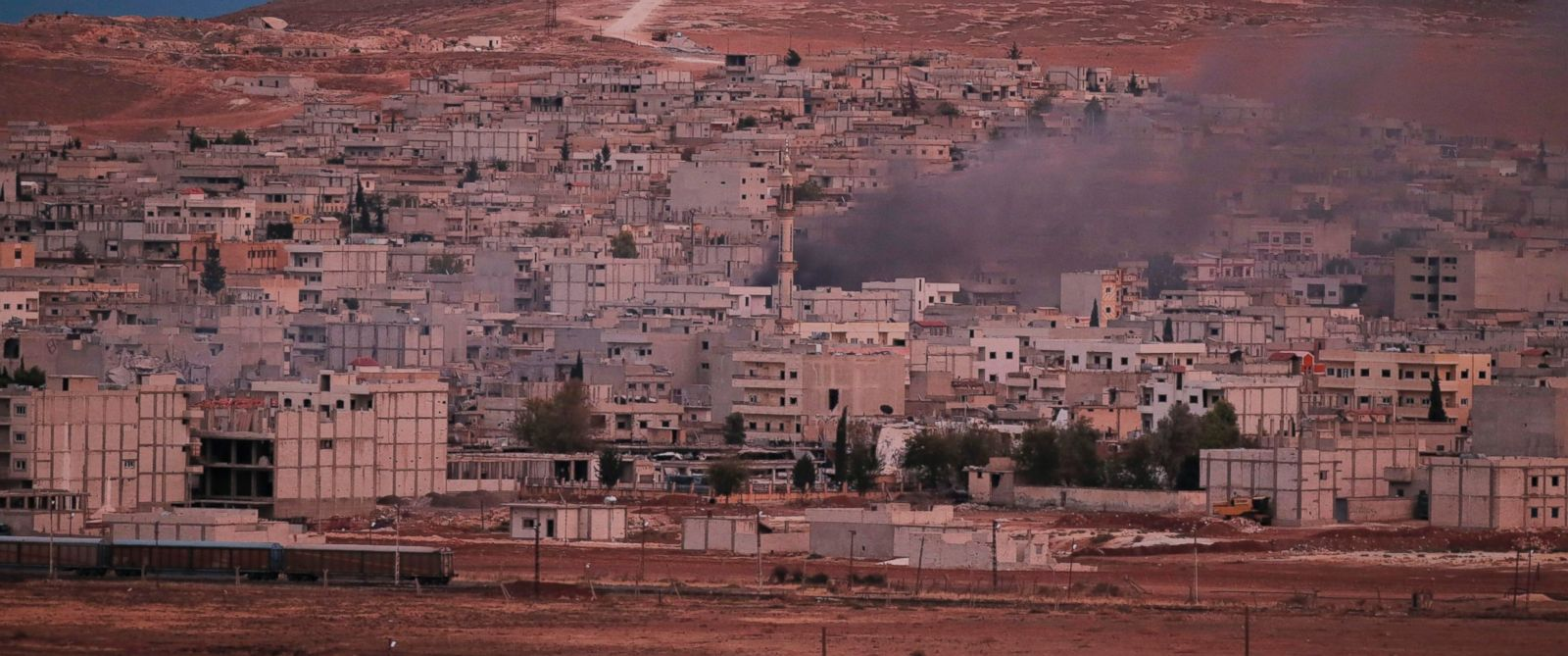 Smoke rises following a strike in Kobani, Syria, during fighting between Syrian Kurds and the militants of Islamic State group, as seen from a hilltop on the outskirts of Suruc, at the Turkey-Syria border, Oct. 19, 2014.