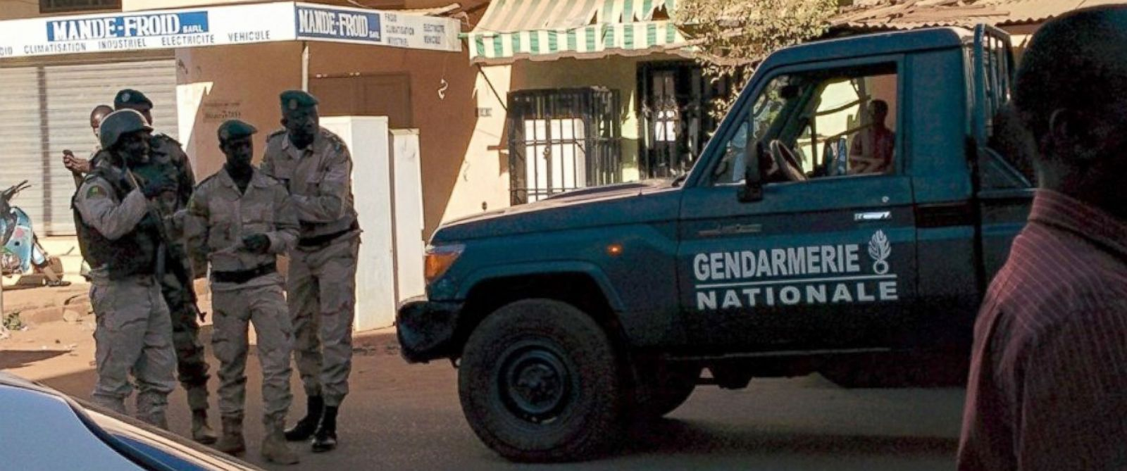 PHOTO: In this image made available by Malikahere.com security personnel, attend close to the scene of an attack on a hotel in Bamako, Mali Friday Nov. 20, 2015.