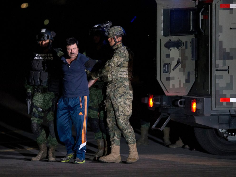 PHOTO: Mexican drug lord Joaquin El Chapo Guzman is escorted by soldiers and marines to a waiting helicopter, at a federal hangar in Mexico City, Jan. 8, 2016.