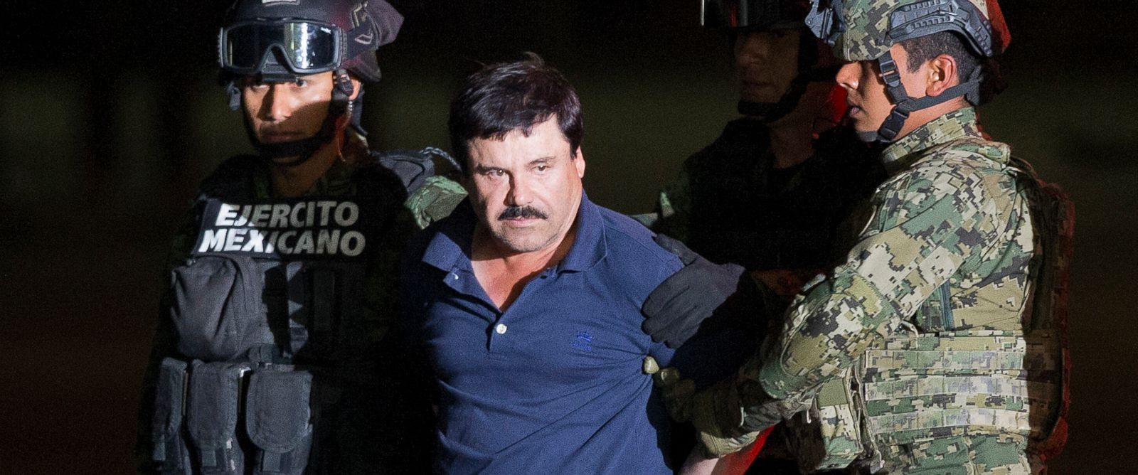 "PHOTO: Joaquin ""El Chapo"" Guzman is made to face the press as he is escorted to a helicopter in handcuffs by Mexican soldiers and marines at a federal hangar in Mexico City, Mexico, Friday, Jan. 8, 2016."