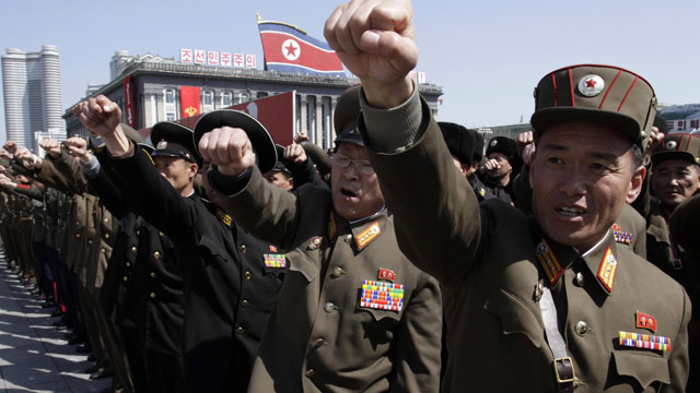 PHOTO: North Korean army officers punch the air as they chant slogans during a rally at Kim Il Sung Square in downtown Pyongyang, North Korea, Friday, March 29, 2013.