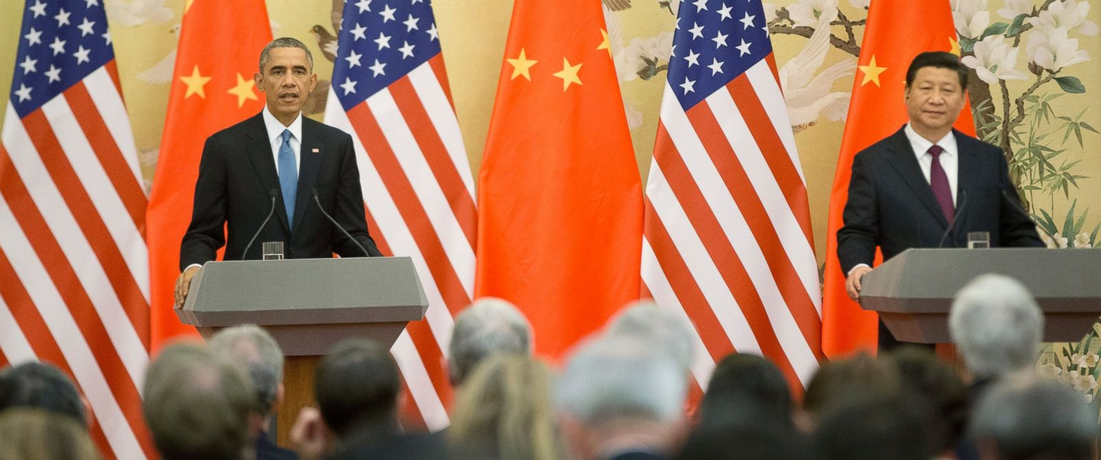U.S. President Barack Obama, left, and Chinese President Xi Jinping, right, speak during a joint news conference at the Great Hall of the People in Beijing, Nov. 12, 2014.