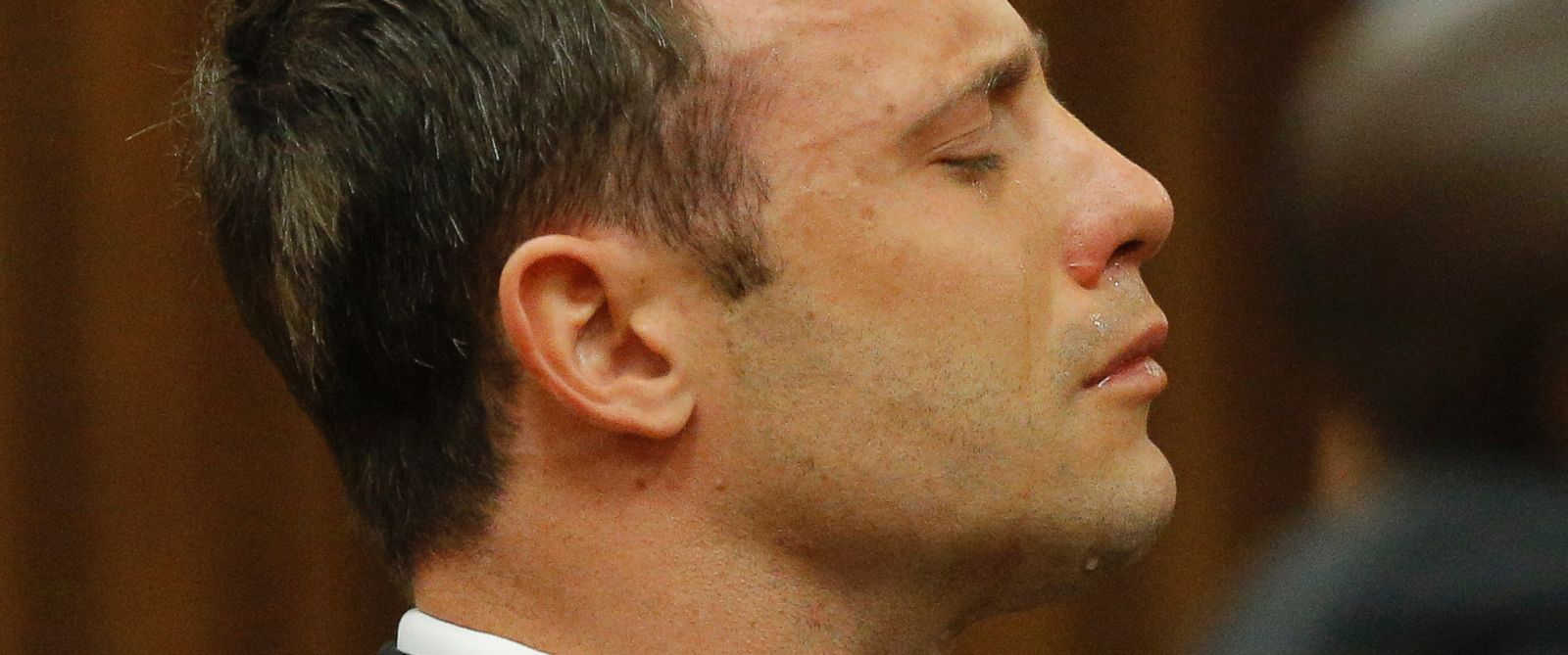 PHOTO: Oscar Pistorius reacts in the dock in Pretoria, South Africa, Sept. 11, 2014 as Judge Thokozile Masipa reads notes as she delivers her verdict in Pistorius murder trial.