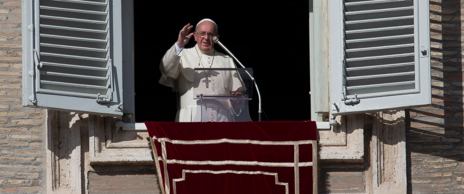 Pope Francis delivers his blessing during the Angelus noon prayer from his studios window overlooking St. Peters Square, at the Vatican, Nov. 16, 2014.
