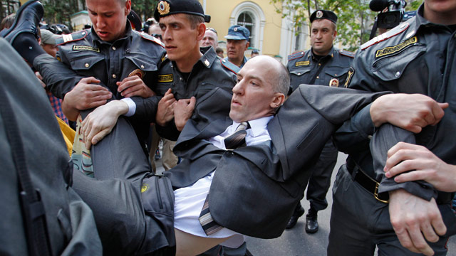PHOTO: Russian police officers detain a gay rights activist during an ...