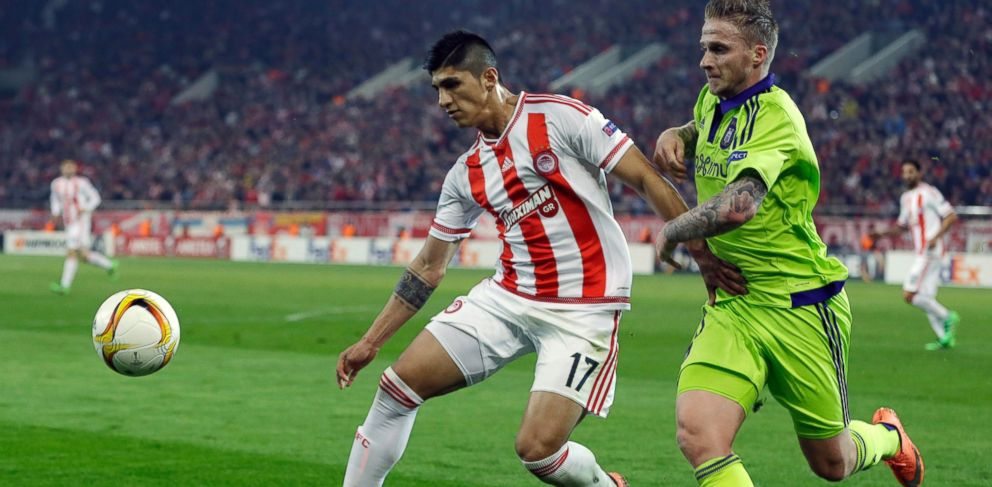 PHOTO: In this Thursday, Feb. 25, 2016 file photo, Olympiakos Alan Pulido, left, fights for the ball with Anderlechts Alexander Buttner during the Europa League round of 32 soccer match in the port of Piraeus, near Athens.