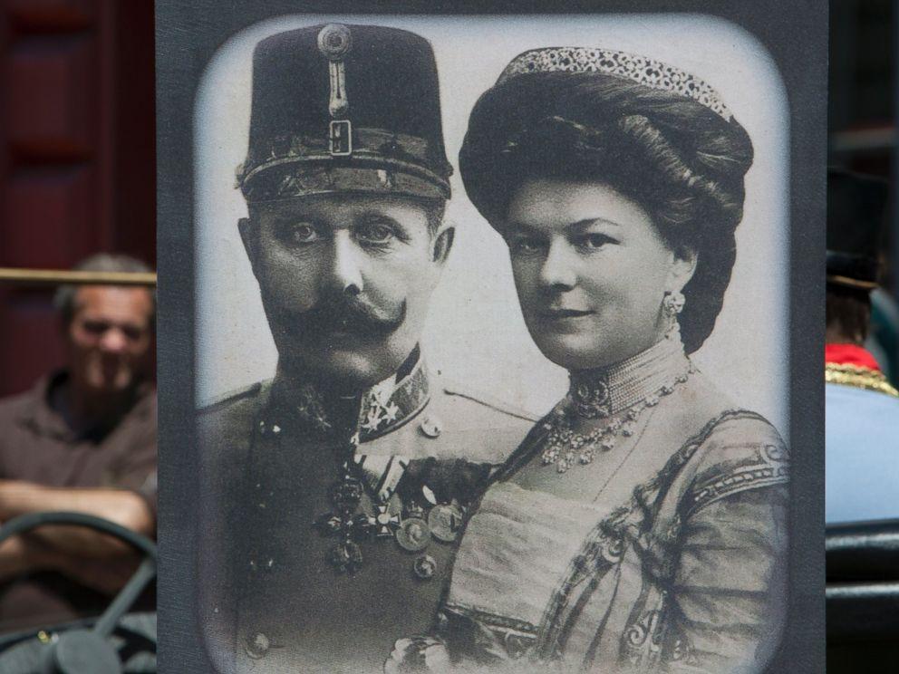 PHOTO: Tourists look at exhibits in Sarajevo museum, including portraits of Archduke Franz Ferdinand and Sofia von Hochenberg, in Sarejevo, Saturday, June 28, 2014.