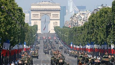 PHOTO: French soldiers stand in an armored vehicle during the Bastille Day parade in Paris, Sunday, July 14, 2013.