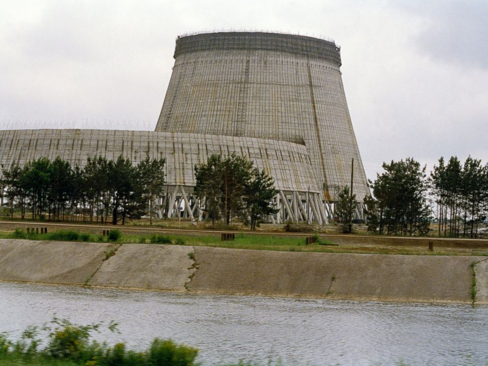 PHOTO: Reactor No. 4 of the Chernobyl nuclear power plant stands encased in lead and concrete following the accident in April 1986, that released a cloud of radiation that circled the world in Pripyat, Ukraine, July 1988.