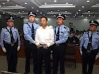 PHOTO: In this photo released by the Jinan Intermediate Peoples Court, fallen politician Bo Xilai, center, is handcuffed and held by police officers as he stands at the court in Jinan, in eastern Chinas Shandong province Sunday, Sept. 22, 2013.