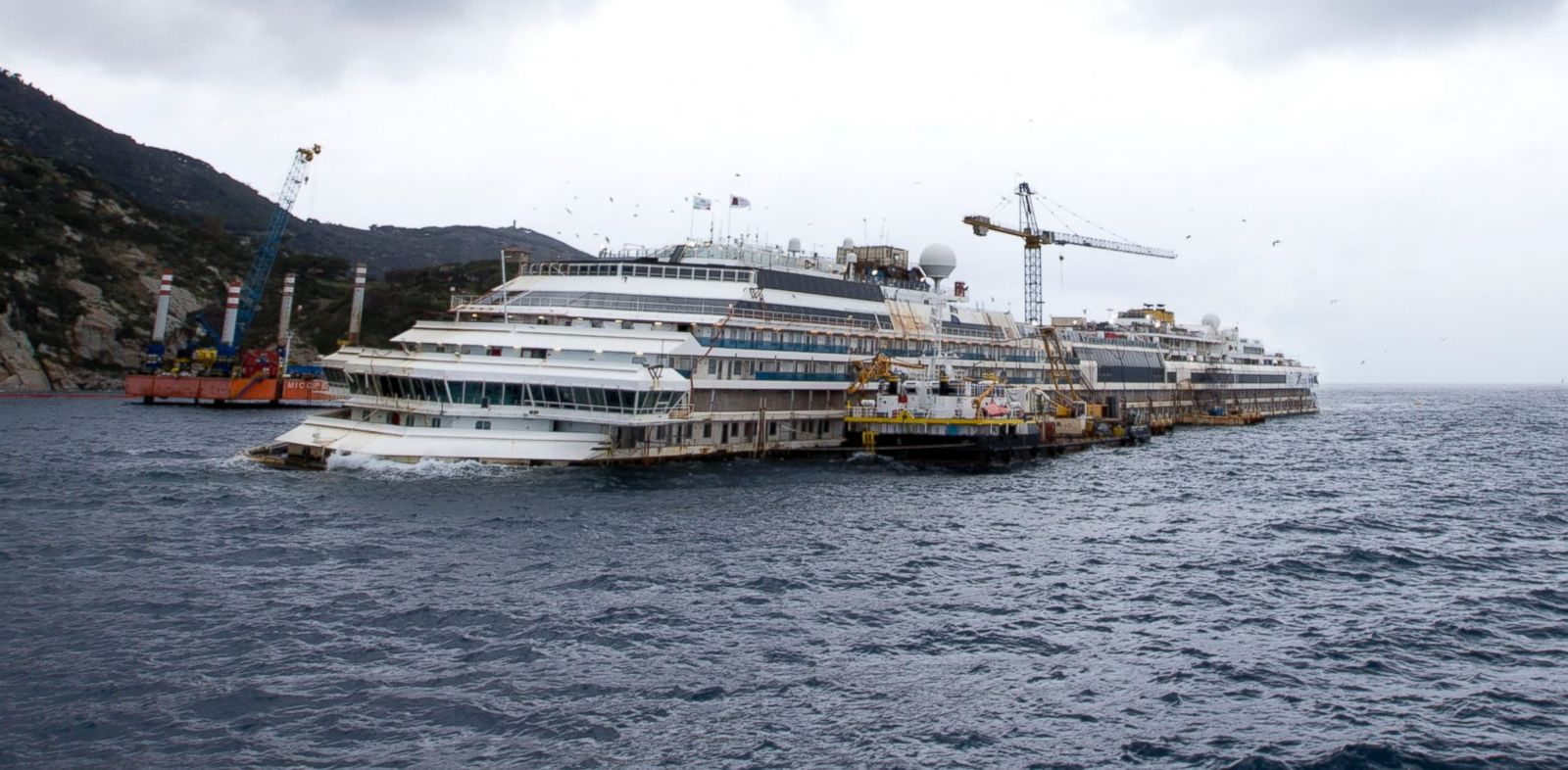 PHOTO: The wreck of the Costa Concordia cruise ship is seen from a ferry boat approaching Tuscan Island of Giglio, Feb. 26, 2014.