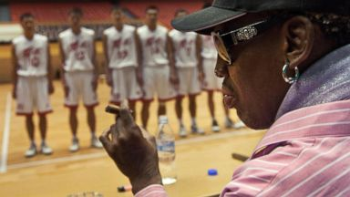 PHOTO: Former NBA basketball player Dennis Rodman holds a cigar as he speaks to North Korean basketball players during a practice session in Pyongyang, North Korea, Dec. 20, 2013.