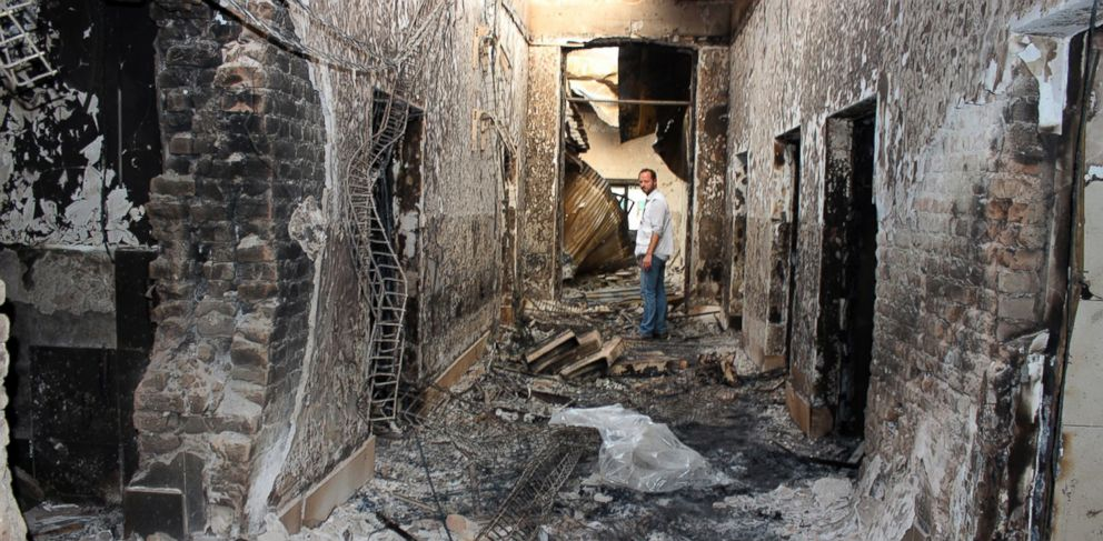 PHOTO: In this Oct. 16, 2015, file photo, an employee of Doctors Without Borders stands inside the charred remains of their hospital after it was hit by a U.S. airstrike in Kunduz, Afghanistan on Oct. 3, 2015.