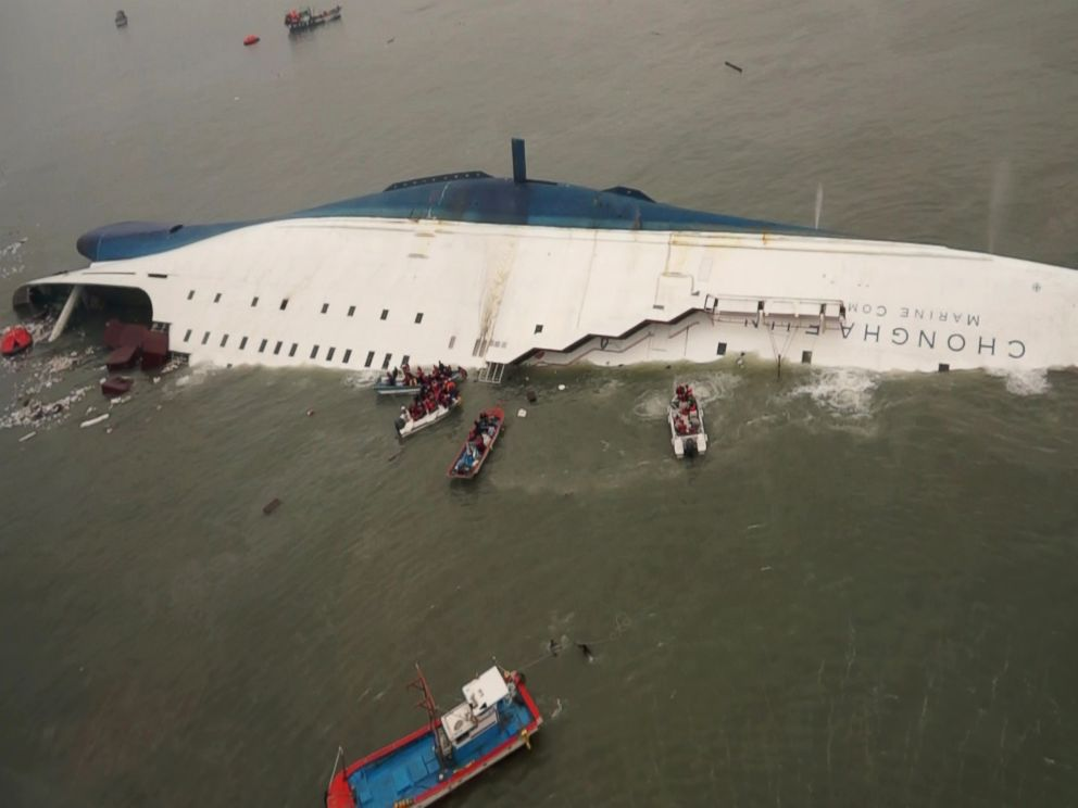 PHOTO: Boat crews try to rescue passengers from a ferry sinking off South Koreas southern coast, in the water off the southern coast near Jindo, south of Seoul, April 16, 2014.