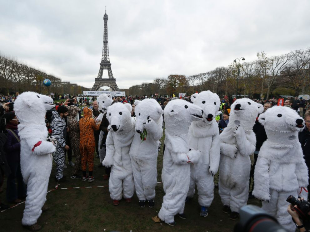 PHOTO: White bears costumed activists demonstrate near the Eiffel Tower, in Paris, Dec.12, 2015 during the COP21, the United Nations Climate Change Conference.