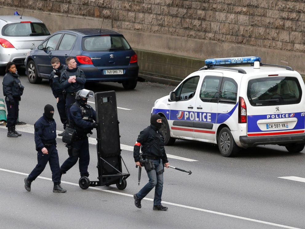 PHOTO: Hooded police officers walk on the closed ring road that circles Paris near a hostage-taking situation at a kosher market in Paris, Jan.9, 2015.